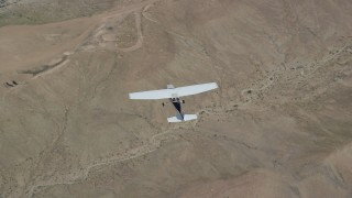 AX139_152 - 6K stock footage aerial video of a bird's eye view of a Cessna flying over desert, Carbon County, Utah