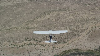 AX139_153 - 6K stock footage aerial video of a bird's eye view of a Cessna airplane flying over desert, Carbon County, Utah