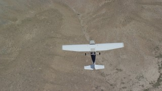AX139_154 - 6K stock footage aerial video of a bird's eye view of a Cessna plane flying over desert, Carbon County, Utah
