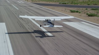 AX139_164 - 6K stock footage aerial video of a Cessna airplane landing at airport, Buck Davis Field, Utah