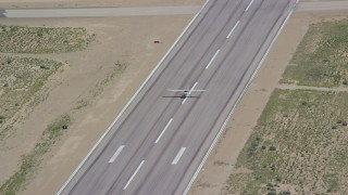 AX140_001 - 6K stock footage aerial video of tracking a Cessna taking off from airport, Buck Davis Field, Utah