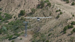 AX140_004 - 6K stock footage aerial video of tracking a Cessna ascending over desert, Price, Utah