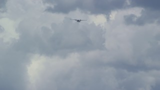 AX140_012 - 6K stock footage aerial video of a Tecnam P2006T flying high in the clouds, Carbon County, Utah