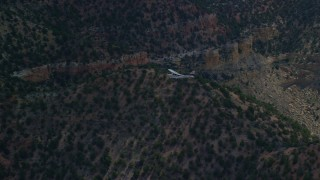 AX140_013 - 6K stock footage aerial video of tracking a Cessna over desert mountains, Carbon County, Utah