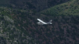 AX140_016 - 6K stock footage aerial video of a view of a Cessna over desert mountains, Carbon County, Utah