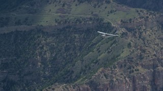 AX140_020 - 6K stock footage aerial video of a Cessna as it flies over desert mountains, Carbon County, Utah