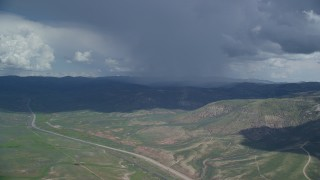 AX140_041 - 6K stock footage aerial video of tracking a Tecnam P2006T near rainstorm and Highway 6, Wasatch Range, Utah County, Utah
