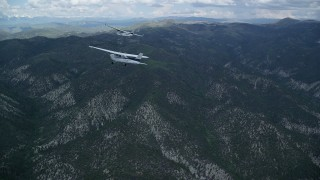 AX140_072 - 6K stock footage aerial video of following a Cessna tailing a Tecnam P2006T over the Wasatch Range, Utah