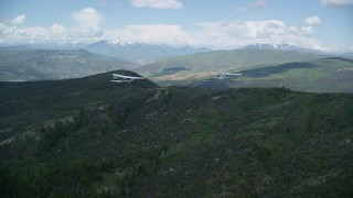 AX140_076 - 6K stock footage aerial video of a Tecnam P2006T leading Cessna over the Wasatch Range, Utah