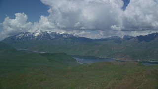 AX140_169 - 6K stock footage aerial video of a wide view of Deer Creek Reservoir, snow-capped Mount Timpanogos, Utah