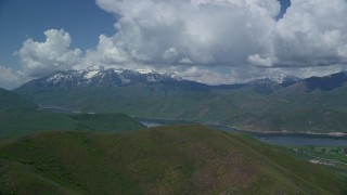 AX140_170 - 6K stock footage aerial video of flying by Deer Creek Reservoir, snow-capped Mount Timpanogos, Utah