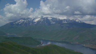 AX140_172 - 6K stock footage aerial video of a view of Deer Creek Reservoir, snow-capped Mount Timpanogos, Utah