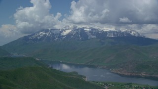 AX140_173 - 6K stock footage aerial video of Deer Creek Reservoir, snow-capped Mount Timpanogos, Utah
