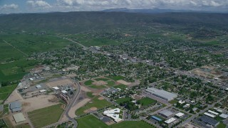 AX140_177 - 6K stock footage aerial video of small town neighborhoods with baseball fields, Heber City, Utah