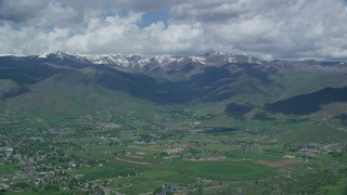 AX140_178 - 6K stock footage aerial video of snowy peaks seen from small town of Midway, Wasatch Range, Utah
