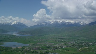 AX140_182 - 6K stock footage aerial video of a view of snowy Mount Timpanogos, Deer Creek Reservoir, seen from Midway, Utah