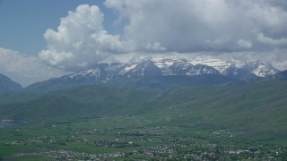 AX140_183 - 6K stock footage aerial video of snow-capped Mount Timpanogos seen from town of Midway, Utah