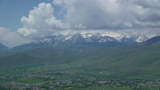 AX140_184 - 6K stock footage aerial video of a wide view of snow-capped Mount Timpanogos, seen from Midway, Utah