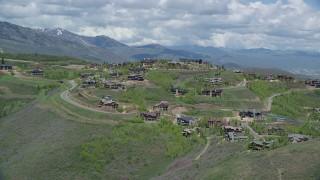 AX140_196 - 6K stock footage aerial video of flying toward upscale mountaintop homes, Deer Valley, Utah