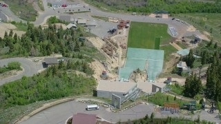 AX140_221 - 6K stock footage aerial video of orbiting the ski jumps at Utah Olympic Park