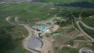 AX140_222 - 6K stock footage aerial video of flying away from aerials pool at Utah Olympic Park