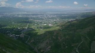 AX140_242 - 6K stock footage aerial video of flying over Wasatch Range toward University of Utah, Downtown Salt Lake City, Utah