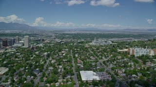 AX140_253 - 6K stock footage aerial video focus on the Utah State Capitol while flying over neighborhoods
