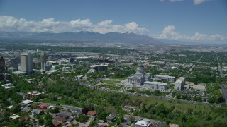 AX140_254 - 6K stock footage aerial video of flying around the Utah State Capitol, view of Downtown Salt Lake City, Utah