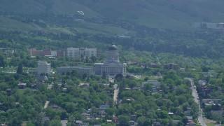 AX140_261 - 6K stock footage aerial video of flying away from the Utah State Capitol, Utah