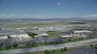 AX140_263 - 6K stock footage aerial video of an approach to the Salt Lake City International Airport, Utah