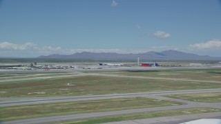 AX140_265 - 6K stock footage aerial video of the control tower at Salt Lake City International Airport, Utah