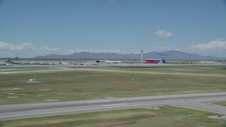 AX140_266 - 6K stock footage aerial video of a view of the control tower at Salt Lake City International Airport, Utah