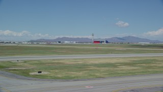 AX140_267 - 6K stock footage aerial video of a wide view of the control tower at Salt Lake City International Airport, Utah