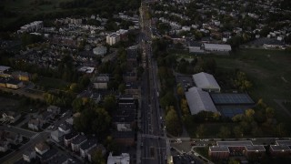 AX141_008 - 6K stock footage aerial video of Blue Hill Avenue, approach downtown skyline, Dorchester, Downtown Boston, Massachusetts, autumn, twilight