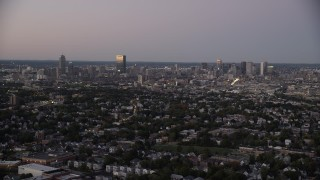 AX141_011 - 6K stock footage aerial video flying by the downtown skyline, Downtown Boston, Massachusetts, twilight