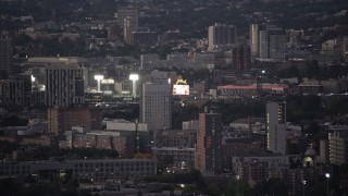 AX141_012 - 6K stock footage aerial video flying by a baseball game at Fenway Park, Boston, Massachusetts, twilight