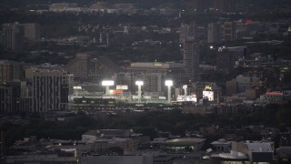 AX141_014 - 6K stock footage aerial video flying by bright lights, baseball game, Fenway Park, Boston, Massachusetts, twilight