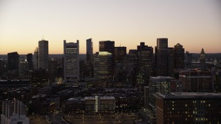 AX141_020 - 6K stock footage aerial video flying by buildings, city streets, skyline, Downtown Boston, Massachusetts, twilight