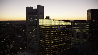 AX141_035 - 6K stock footage aerial video of Russia Wharf, Federal Reserve Bank, Downtown Boston, Massachusetts, twilight