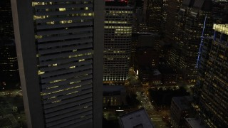 AX141_036 - 6K stock footage aerial video orbiting Federal Reserve Bank Building, Russia Wharf, Downtown Boston, Massachusetts, twilight