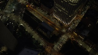 AX141_054 - 6K stock footage aerial video of a bird's eye view over skyscrapers, city streets, Downtown Boston, Massachusetts, night