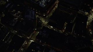 AX141_055 - 6K stock footage aerial video of a bird's eye view over city streets, Downtown Boston, Massachusetts, night