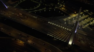 AX141_063 - 6K stock footage aerial video of a bird's eye view flying over Zakim Bridge, light traffic, Boston, Massachusetts, night