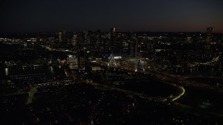 AX141_066 - 6K stock footage aerial video flying by skyline, approaching Zakim Bridge, Downtown Boston, Massachusetts, night