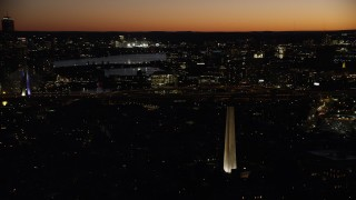 AX141_070 - 6K stock footage aerial video orbiting Bunker Hill Monument, Zakim Bridge, Charlestown, Massachusetts, twilight