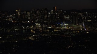 AX141_072 - 6K stock footage aerial video approaching Zakim Bridge, TD Garden, Downtown Boston, Massachusetts, night
