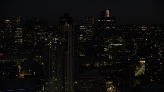 AX141_074 - 6K stock footage aerial video flying by TD Garden, Avalon North Station, Downtown Boston, Massachusetts, night
