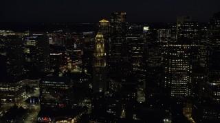 AX141_077 - 6K stock footage aerial video orbiting Custom House Tower, Downtown Boston, Massachusetts, night