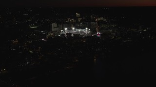 AX141_084 - 6K stock footage aerial video flying by baseball game in progress at Fenway Park, Boston, Massachusetts, night