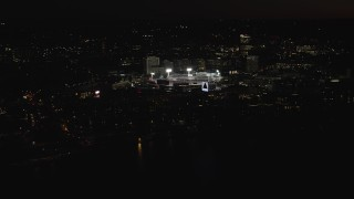 AX141_085 - 6K stock footage aerial video flying by baseball game, Boston Red Socks, Fenway Park, Boston, Massachusetts, night